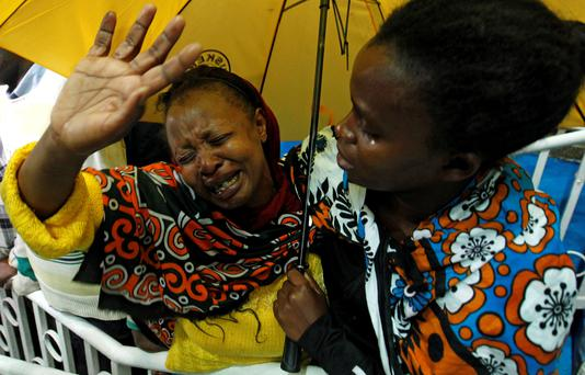 A woman reacts after seeing her son who was rescued from the Garissa University attack in Kenya's capital Nairobi. The stadium is now a crisis centre manned by the Red Cross, for families to find out whether their relatives are alive or dead (REUTERS/Thomas Mukoya)