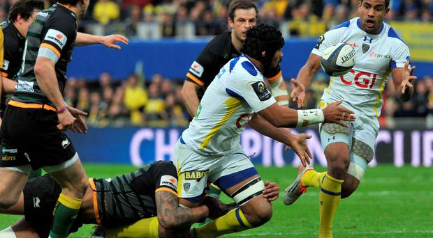 Clermont's New Zealander flanker Fritz Lee (C) passes the ball to Clermont's French centre Wesley Fofana (R) during the European Rugby Champions Cup 1/4 final match between Clermont and Northampton on April 4, 2015 at the Michelin stadium in Clermont-Ferrand, central France. AFP PHOTO / THIERRY ZOCCOLANTHIERRY ZOCCOLAN/AFP/Getty Images