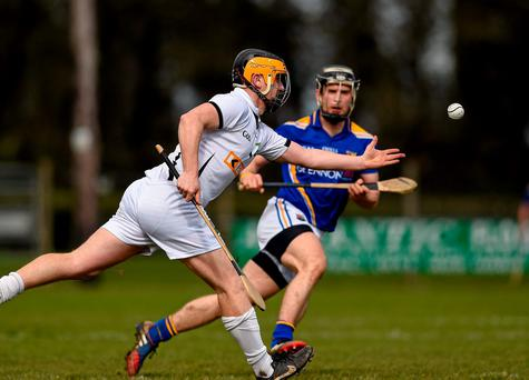 Chris Brough, Warwickshire, in action against Cathal Mullane, Longford