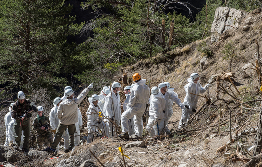 Rescue workers and investigators, seen in this picture made available to the media by the French Interior Ministry April 3, 2015, work at the crash site of a Germanwings Airbus A320, near Seyne-les-Alpes. The co-pilot, Andreas Lubitz, 27 of a Germanwings jet that crashed in the French Alps increased the airplane's speed before it crashed killing all 150 people on board, according to French investigators. France's BEA crash investigation agency said on Friday it was still reconstructing the flight, but the chilling new detail from a second 'black box' flight data recorder appeared to corroborate prosecutors' suggestions that the co-pilot acted deliberately. REUTERS/French Interior Ministry/DICOM/Yves Malenfer/Handout NO ARCHIVES. FOR EDITORIAL USE ONLY. NOT FOR SALE FOR MARKETING OR ADVERTISING CAMPAIGNS. THIS IMAGE HAS BEEN SUPPLIED BY A THIRD PARTY. IT IS DISTRIBUTED, EXACTLY AS RECEIVED BY REUTERS, AS A SERVICE TO CLIENTS