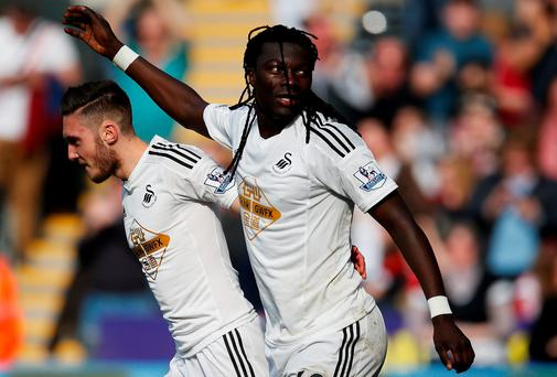 Swansea City's Bafetimbi Gomis celebrates after scoring his second goal against Hull City