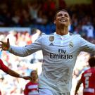 Real Madrid's Portuguese forward Cristiano Ronaldo celebrates a goal during the Spanish league football match Real Madrid CF vs Granada FC at the Santiago Bernabeu stadium in Madrid on April 5, 2015. AFP PHOTO/ GERARD JULIENGERARD JULIEN/AFP/Getty Images