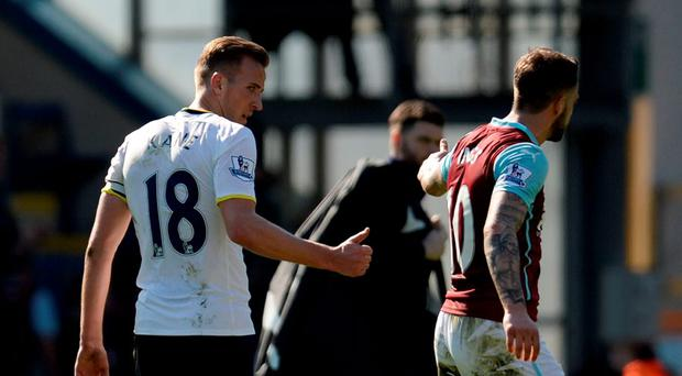 Burnley's Danny Ings talks with Tottenham Hotspur's Harry Kane after the final whistle . OLI SCARFF/AFP/Getty Images