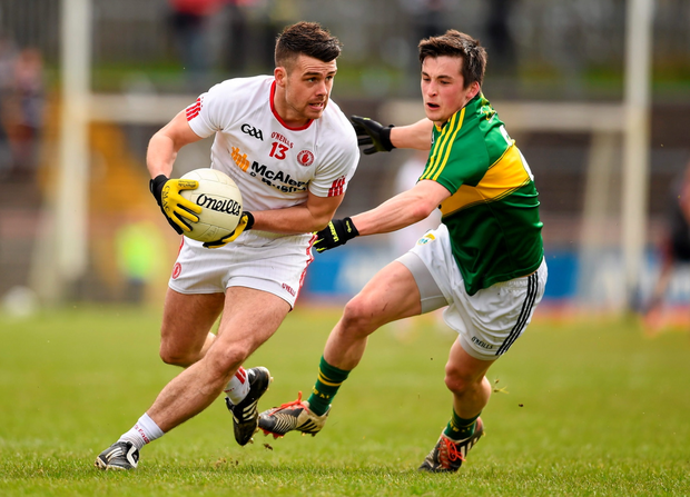 5 April 2015; Darren McCurry, Tyrone, in action against Paul Murphy, Kerry. Allianz Football League, Division 1, Round 7, Tyrone v Kerry. Healy Park, Omagh, Co. Tyrone. Picture credit: Stephen McCarthy / SPORTSFILE