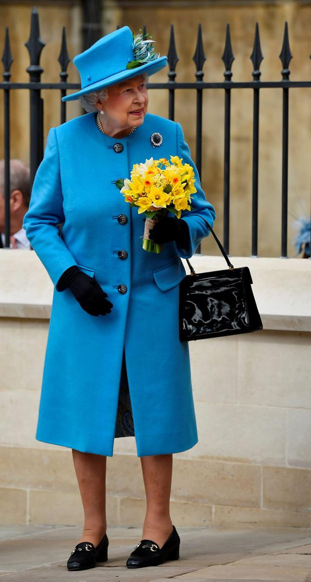 Britain's Queen Elizabeth leaves after attending the Easter Sunday service at St George's Chapel at Windsor Castle
