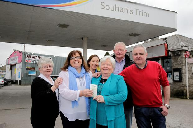 1/4/15 Sheila Carroll, Nicky Souhan, Hellen Morris, Ena Souhan, Jim Toole and Darren Souhan celebrate selling the winning ticket for saturday nights jackpot of 10.5 million euro at Souhan's service station in Trim, Co Meath. Picture:Arthur Carron