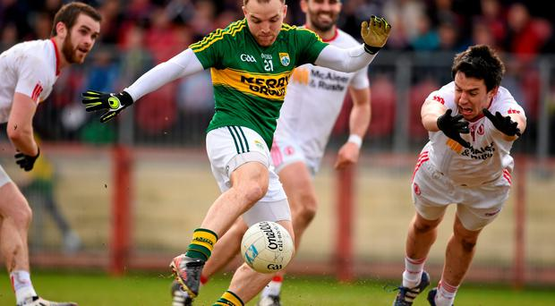 Tyrone's Matthew Donnelly attempts to get a block on the shot of Kerry's Darran O'Sullivan during their Allianz NFL clash