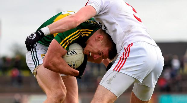 Tommy Walsh attempts to get past Tyrone's Ronan McNamee during their game in Omagh