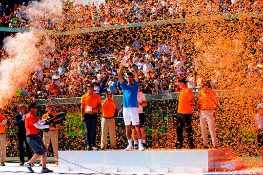 KEY BISCAYNE, FL - APRIL 05: Novak Djokovic of Serbia holds the Butch Bucholz trophy after his three set victory against Andy Murray of Great Britain in the mens final during the Miami Open Presented by Itau at Crandon Park Tennis Center on April 5, 2015 in Key Biscayne, Florida. (Photo by Clive Brunskill/Getty Images)