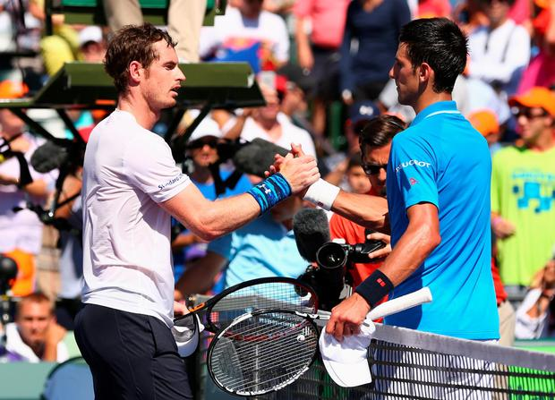 KEY BISCAYNE, FL - APRIL 05: Novak Djokovic of Serbia shakes hands at the net after his three set victory against Andy Murray of Great Britain in the mens final during the Miami Open Presented by Itau at Crandon Park Tennis Center on April 5, 2015 in Key Biscayne, Florida. (Photo by Clive Brunskill/Getty Images)