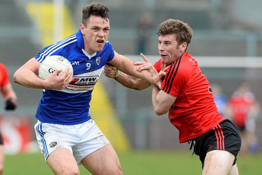 Laois' John O'Loughlin in action against Luke Howard of Down