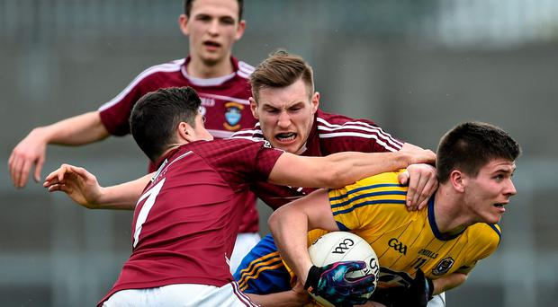 Roscommmon's Mark Healy is tackled by Westmeath duo John Egan (left) and Kieran Martin during their Allianz NFL clash