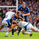 Sean Cronin, Leinster, is tackled by Jonathan Joseph, left, and Paul James, Bath