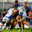 Jordi Murphy, Leinster, is tackled by Matt Banahan, left, and Leroy Houston, Bath