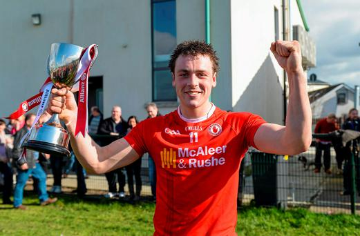 Tyrone's Damien Casey holds the trophy aloft