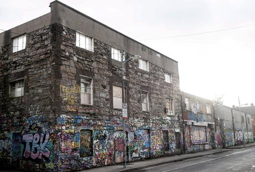 Only the the infamous graffiti covered 'U2 Wall' is remaining