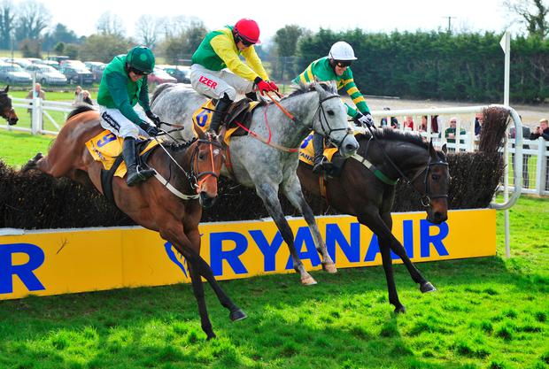 Gilgamboa ridden by Tony McCoy (right) jumps the last to win the Ryanair Gold Cup during Ryanair Gold Cup Day at Fairyhouse Racecourse, Ratoath, Ireland