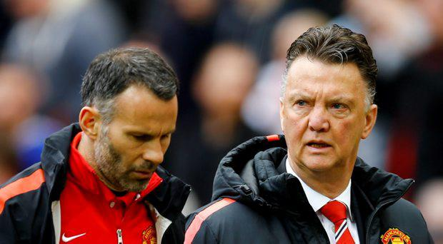 Manchester United manager Louis Van Gaal and assistant manager Ryan Giggs