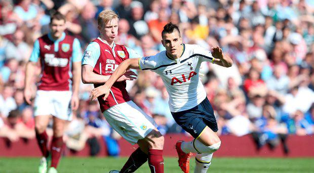 Tottenham Hotspur's Erik Lamela (right) and Burnley's Ben Mee (left) battle for the ball during the Barclays Premier League match at Turf Moor, Burnley