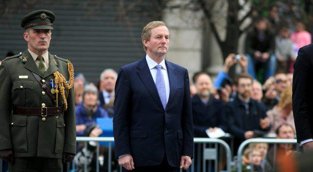 An Taoiseach, Enda Kenny, TD during a ceremony to marking the 99th Anniversary of the 1916 Easter Rising at the GPO, O'Connell Street, Dublin