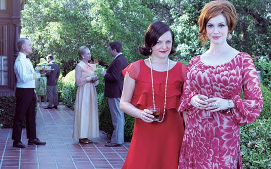 MAD MEN - Elisabeth Moss as Peggy Olson and Christina Hendricks as Joan Harris