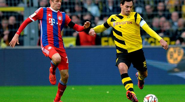 Thomas Muller vies with Mats Hummels on Saturday night