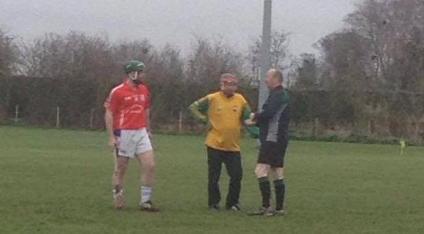 Johnny McEvoy converses with the referee