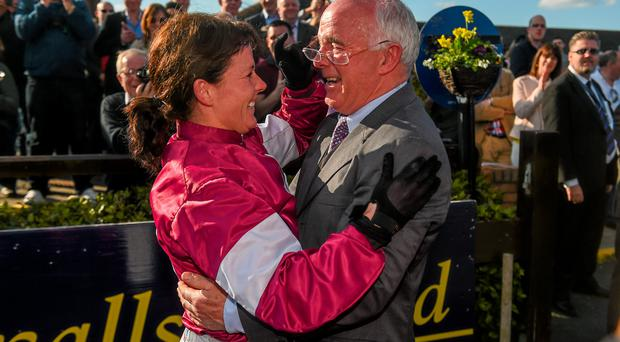 Jockey Katie Walsh celebrates with her father and trainer Ted Walsh after her mount Thunder And Roses won the BoyleSports Irish Grand National Steeplechase. Fairyhouse Easter Festival, Fairyhouse, Co. Meath. Picture credit: Pat Murphy / SPORTSFILE