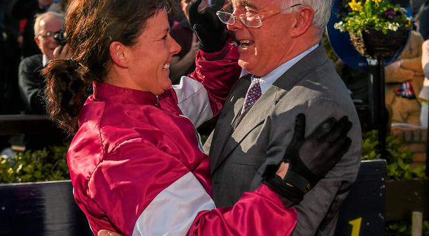 Katie Walsh celebrates with her father Ted after guiding Thunder And Roses to victory in the BoyleSports Irish Grand National at Fairyhouse