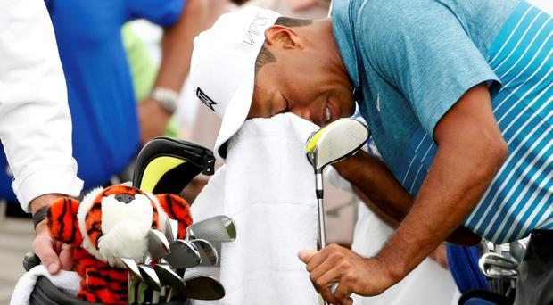 Tiger Woods of the U.S. wipes his face before hitting off the first tee during his practice round ahead of the 2015 Masters at the Augusta National Golf Course in Augusta, Georgia April 6, 2015. REUTERS/Phil Noble