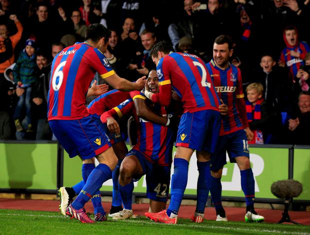 Crystal Palace's Jason Puncheon (centre) is surrounded by teammates as he celebrates scoring his side??s second goal of the game during the Barclays Premier League fixture at Selhurst Park, London. PRESS ASSOCIATION Photo. Picture date: Monday April 6, 2015. See PA Story SOCCER Palace. Photo credit should read: Jonathan Brady/PA Wire. RESTRICTIONS: Editorial use only. Maximum 45 images during a match. No video emulation or promotion as 'live'. No use in games, competitions, merchandise, betting or single club/player services. No use with unofficial audio, video, data, fixtures or club/league logos.