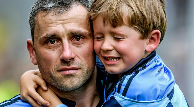 Alan Brogan, pictured with his son Jamie after last year's defeat to Donegal, was forced to deny he was set to retire after Dublin's Championship exit