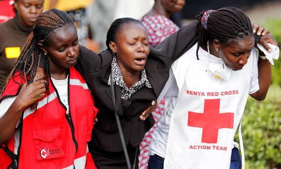 A relative, centre, is assisted by Kenya Red Cross staff as she reacts at the Chiromo Mortuary, where bodies of students killed in Thursday's attack by gunmen are preserved, in Nairobi, after the Islamist group massacred students at a Kenyan university last week (REUTERS/Thomas Mukoya)