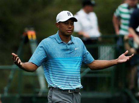 Tiger Woods gestures after teeing off on the fifth hole during a practice round for the Masters golf tournament Monday, April 6, 2015, in Augusta, Ga. (AP Photo/Chris Carlson)