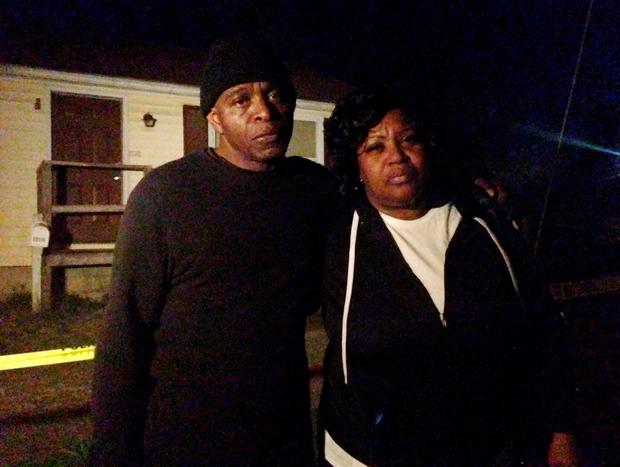 Lloyd Edwards, left, and Bonnie Edwards, the stepfather and mother of Rodney Todd stand outside the home where Todd and his seven children found dead Monday, April 6, 2015, in Princess Anne, Md. (AP Photo/Juliet Linderman)
