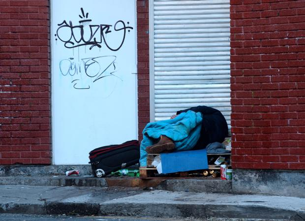 Man sleeping rough on Bachelors Way, off Bachelors Walk, Dublin