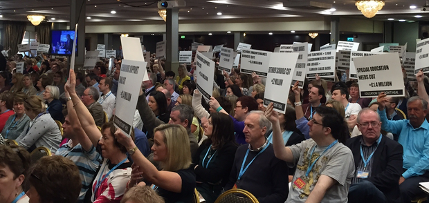 NI Education Minister John O'Dowd faced with placards protesting cuts in North at INTO conference in Ennis. Pic Lise Hand