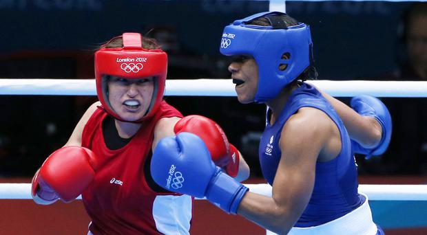 Ireland's Katie Taylor (left) during her quarter final victory in the Women's Boxing 60kg category over Great Britain's Natasha Jonas at the ExCel Arena, on the tenth day of the London 2012 Olympics.