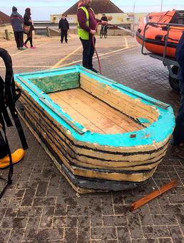 Undated handout photo issued by Clacton RNLI of a boat made by two men for less than £10 after they were rescued by lifeguards when the oars broke and they drifted 200 metres (656 ft) off Jaywick, Essex, yesterday. Photo: Clacton RNLI/PA Wire