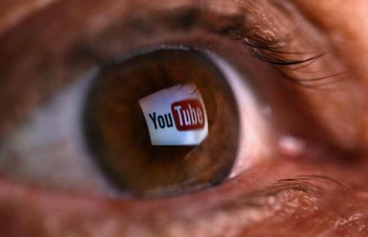 A picture illustration shows a YouTube logo reflected in a person's eye, in central Bosnian town of Zenica, early June 18, 2014.REUTERS/Dado Ruvic