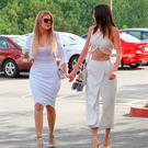 Khloe Kardashian and Kendall Jenner are seen at church for Easter in Los Angeles on April 05, 2015 in Los Angeles, California. (Photo by Bauer-Griffin/GC Images)