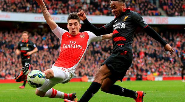 Raheem Sterling is tackled by Arsenal's Hector Bellerin at the Emirates. On a disastrous day for Liverpool, Sterling was still their best player