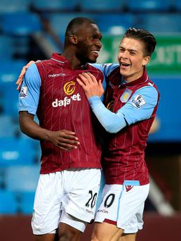 Aston Villa's Christian Benteke (left) celebrates scoring his side's second goal of the game with teammate Jack Grealish (right) during the Barclays Premier League match at Villa Park, Birmingham. PRESS ASSOCIATION Photo. Picture date: Tuesday April 7, 2015. See PA story SOCCER Villa. Photo credit should read: Nick Potts/PA Wire. RESTRICTIONS: Editorial use only. Maximum 45 images during a match. No video emulation or promotion as 'live'. No use in games, competitions, merchandise, betting or single club/player services. No use with unofficial audio, video, data, fixtures or club/league logos.