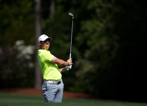 Rory McIlroy of Northern Ireland hits off the 12th tee during his practice round ahead of the 2015 Masters at Augusta National Golf Course in Augusta, Georgia April 7 (REUTERS/Jim Young)