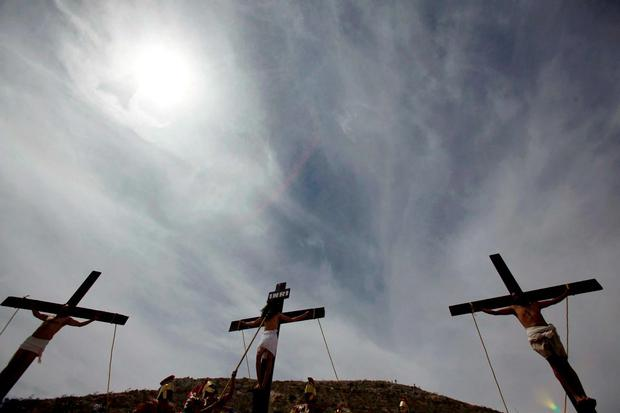 Actors are seen on crosses during a re-enactment of the crucifixion of Jesus Christ during a Good Friday procession in Ciudad Juarez. Reuters