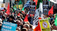 Thousands of anti austerity water protesters march through Dublin city centre on March 21, as