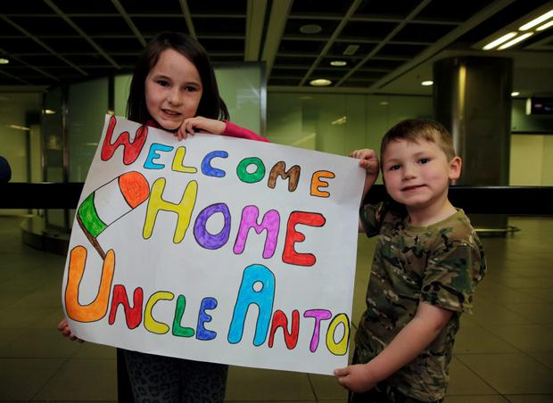 Ella Harney, age 8 and brother Aidan, 4, Brannocks town, Kildare pictured at Dublin airport waiting for members of the Irish Army to return from peace keeping duty in Golan Heights. Picture:Arthur Carron