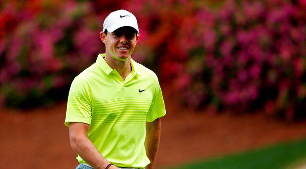 Rory McIlroy of Northern Ireland smiles during a practice round prior to the start of the 2015 Masters Tournament at Augusta National Golf Club on April 7, 2015 in Augusta, Georgia