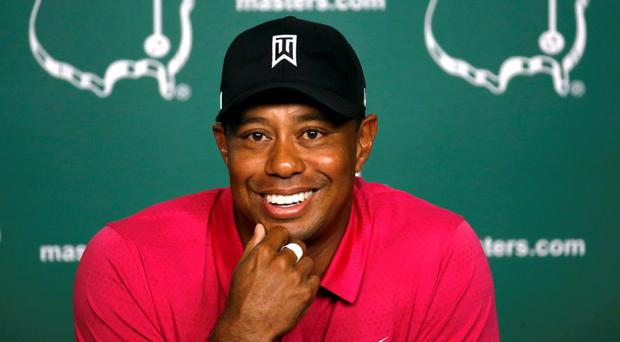 Tiger Woods of the U.S. smiles during a press conference at Augusta National held during practice rounds ahead of the 2015 Masters at the Augusta National Golf Course in Augusta, Georgia