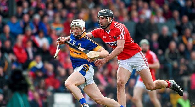 Brendan Maher, Tipperary, in action against Mark Ellis, Cork